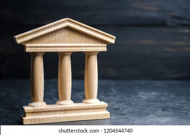 Bank. State Building. wooden government building on a black background. concept of state administration and economic institutions. Municipality, government, elections.