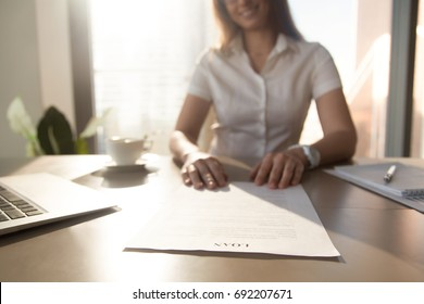 Bank worker offering to read terms of business loan agreement for home purchase, female financial advisor consulting client about commercial credit, mortgage contract, focus on document, close up