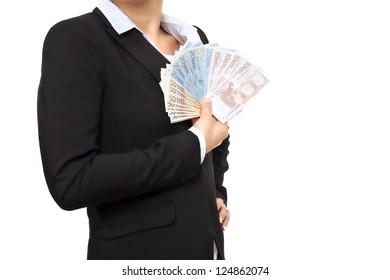 Banker in black business suit holding Euro bills