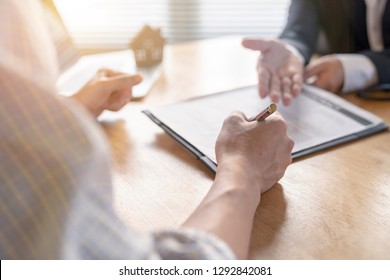Banker business man and client signing contrac document for comfirm corporation or finished loan agreement for house or building property.Docum