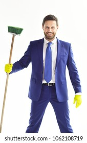 Banker or director holds cleaning supplies and smiles. Happy businessman with beard and mop. Bearded man in formal suit with tie, smilling face and sweep. Housework, cleaning service, office concept.