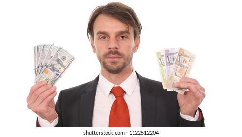 Banker Man Showing Saudi Arabian Sar Bills Money Vs American Dollars Usd Banknotes, Bank Foreign Exchange Rates Concept