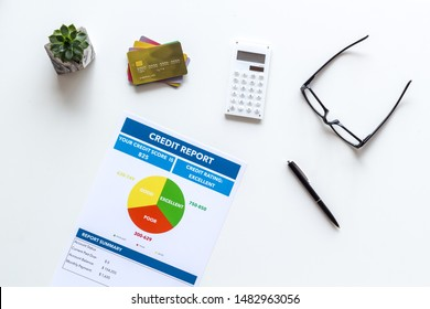 banker office desk with cards, glasses, credit report on white background top view
