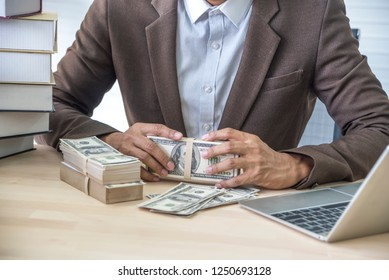 Banker and rich businessman   sitting  in cash count in office . Finance concept