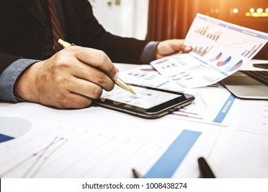 Bankers are analyzing financial data. To sum up the deposit and withdraw daily.
