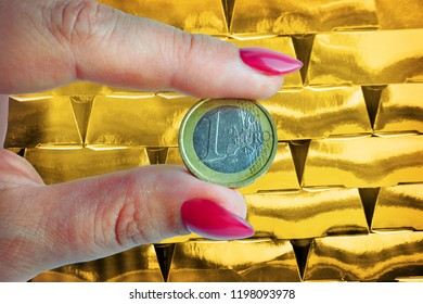 Banking concept, Euro coin in fingers to invest to gold banking business.
