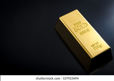 Banking and financial industry concept with a gold bar and copy space. Although the gold standard has passed, a declining US dollar means rising gold prices