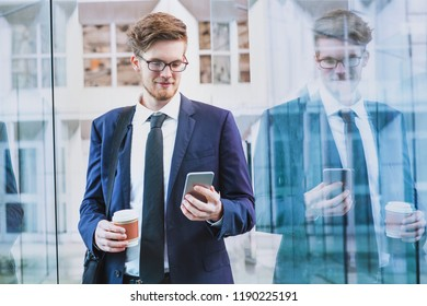 banking online, businessman using smartphone mobile app outside