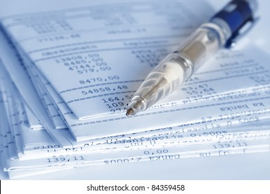 Banking reports on a folded sheets and pen
