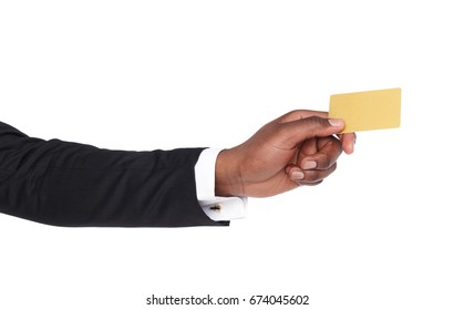Banking services. Black businessman hand holding plastic credit card on white isolated studio background, copy space, cutout
