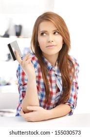 banking and shopping concept - pensive teenage girl with credit card