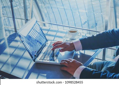 banking or shopping online, e-commerce concept, closeup of hands of businessman working on computer, writing email to customer, business man executive typing on keyboard