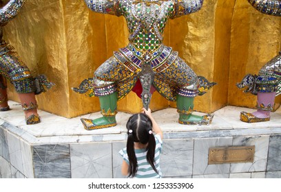 BANKKOK, THAILAND - NOV 8 2018; The girl playing inside the temple.