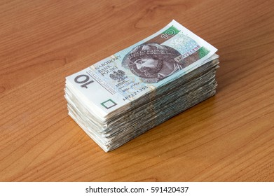 Banknote bundle on wooden background. A lots of 10 PLN banknotes. Polish money.