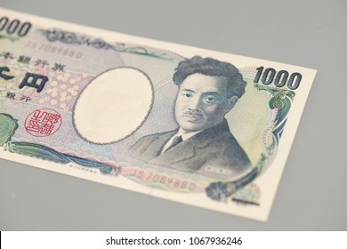 Banknote of the Japanese 1000 Yen on gray background