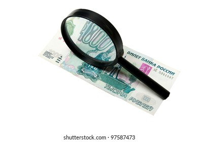 Banknote and magnifying glass isolated on white
