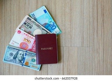 banknote many currency, yen-Japan,dollar-USA,yuan-China, euro-EU with passport book.image for background ,wallpaper and copy space.saving for travel in holidays concept.dollor banknote.dollor currency