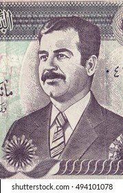 Banknote with the portrait of Saddam Hussein