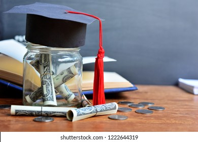 banknote saving in glass cover with hat graduation model for concept education finance and scholarships