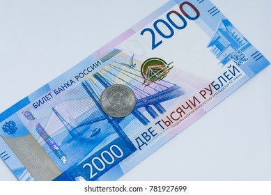 Banknote of two thousand rubles and rubles coin. 2000 rub. Papermoney, cash