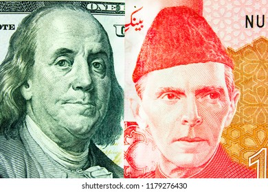 Banknotes 100 US dollars and 100 Pakistani rupees,  portrait of Franklin and  portrait of Mohammad Ali Jinn. Concept of  exchange rate, Internet trading.