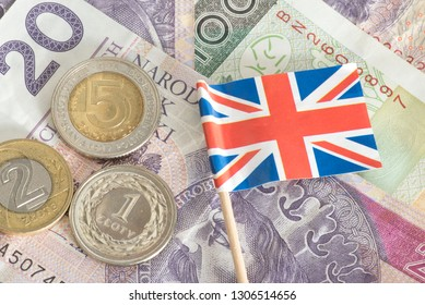 Banknotes and coins Polish zloty PLN and flag of Great Britain