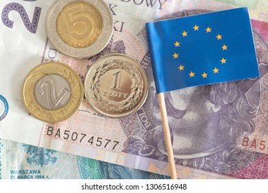 Banknotes and coins Polish zloty PLN and flag of European Union EU