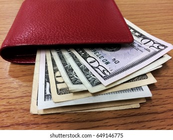 The banknotes dollars,American dollars in the bag on wooden table background.Concept for business .
