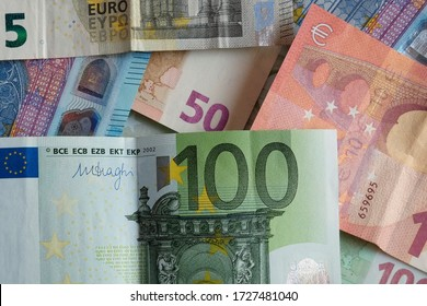 Banknotes of Euro, paper money on flat lay close-up view. Different value  bills together, overlapping each other. Represents the currency of European Union countries.