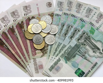 Banknotes face value in one thousand and one hundred rubles and coins, Russian money, macro mode