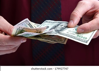 Banknotes in the hands of a businessman.