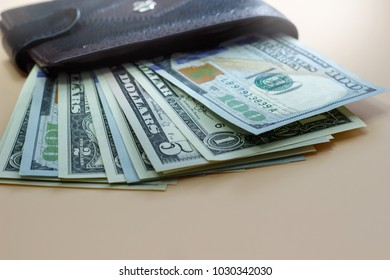 Banknotes in a purse on a wooden table
