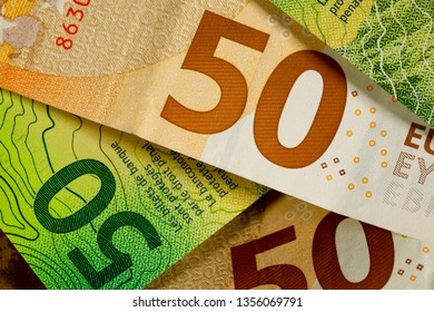 Banknotes of Swiss francs and euro money. This paper money forms the financial backdrop.