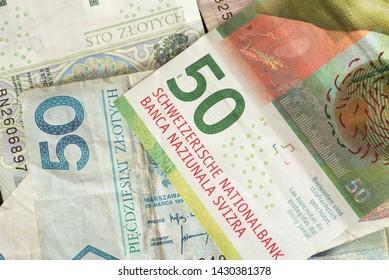 Banknotes Swiss Francs and Polish Zloty