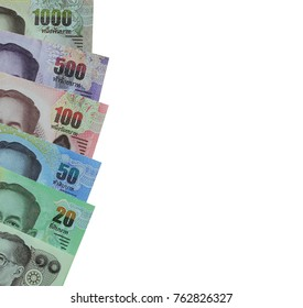 Banknotes of Thailand stacked isolated on white background and have clipping paths for financial design concepts in your work.