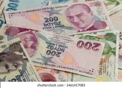 Banknotes of Two Hundred Turkish Liras on the other banknotes.