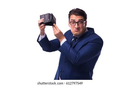 Bankrupt broke businessman with empty wallet on white background