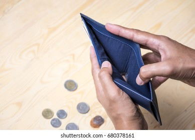 Bankrupt concept, Financial problems empty wallet no have money with wooden background