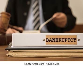 Bankruptcy document folder with lawyer work at law firm.