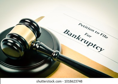 Bankruptcy document with wooden gavel, Buseniss concept.