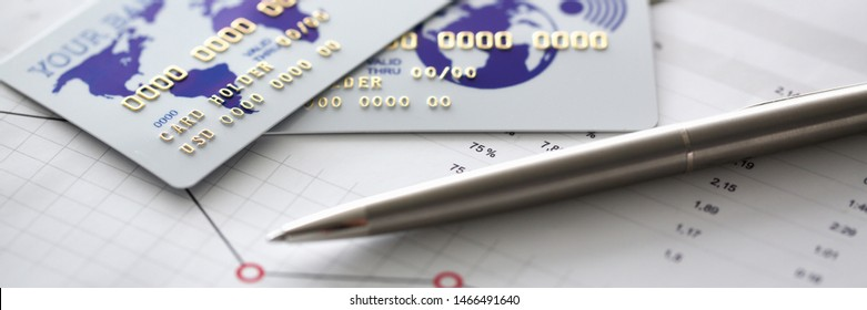 Banks card are on chart with financial statistic background. Salary statement and remittance concept