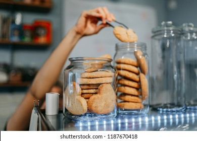 banks with cookies in a shop window in a cafe - Shutterstock ID 1187670418