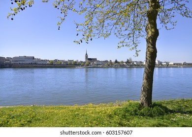 The banks of the Loire at Saumur with the church in the background, commune in the Maine-et-Loire department , Pays de la Loire region in western France.