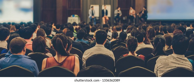 Banner of Abstract blurred photo of conference hall or seminar room with attendee background