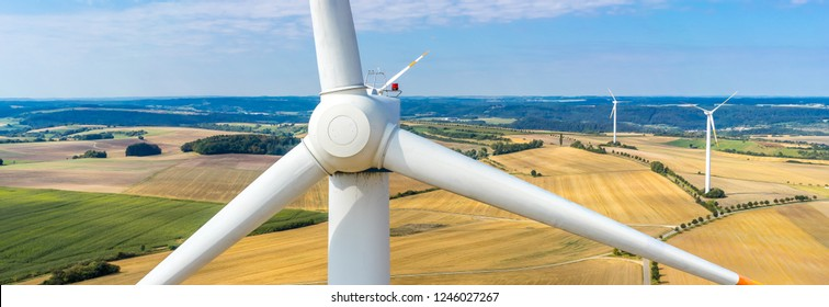Banner aerial view and close-up of a wind turbine