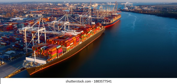 Banner - Aerial view of colorful containers on cargo ships at the port of Southampton, which is one of the Leading Port Terminal Operators in the UK. Space for text.