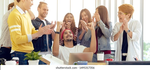 Banner of asian college group celebrate win success with team feeling happy. Asian young creative team engaged together in office party with small snack, food, drink, lunch in break time.