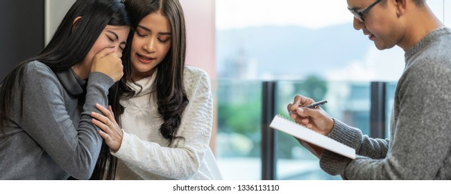 Banner of Asian male professional psychologist doctor giving the consult to Lesbian lovers patients which have relationship problem in modern living room of house, Mental health Concept