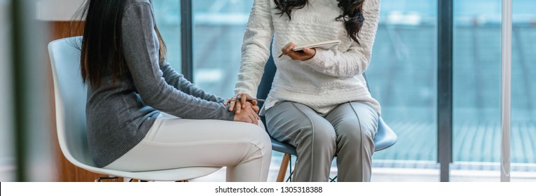 Banner of Asian woman professional psychologist doctor giving the consult to female patients in modern living room of house or hospital exam room, Mental health Concept