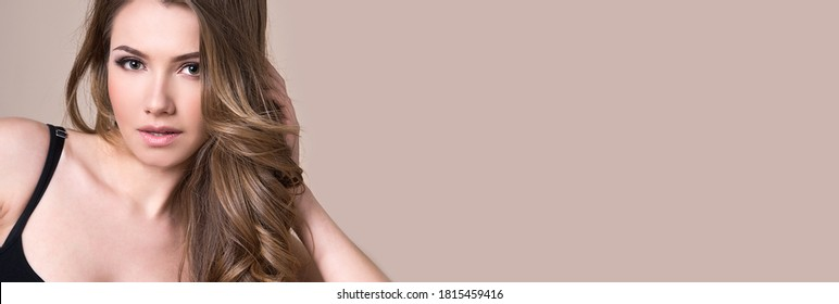 Banner. Beautiful woman with long curly hair. Make up. Hair care. Beauty salon.
